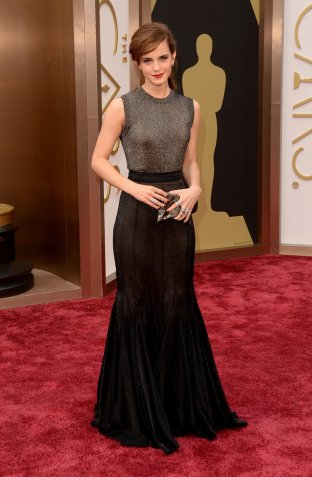I hate to do it, but Emma Watson's dressed looked half Vera Wang, half Urban Outfitters. No longer the poster girl for pixie cuts, Emma struggled with her hairstyle. Designer: Vera Wang.