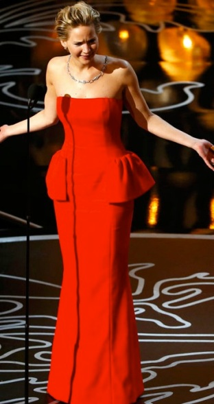 Jennifer Lawrence looked like Hilary Clinton. She also repeated her draped- back necklace (and bad stage manners) from last year. Designer: Dior
