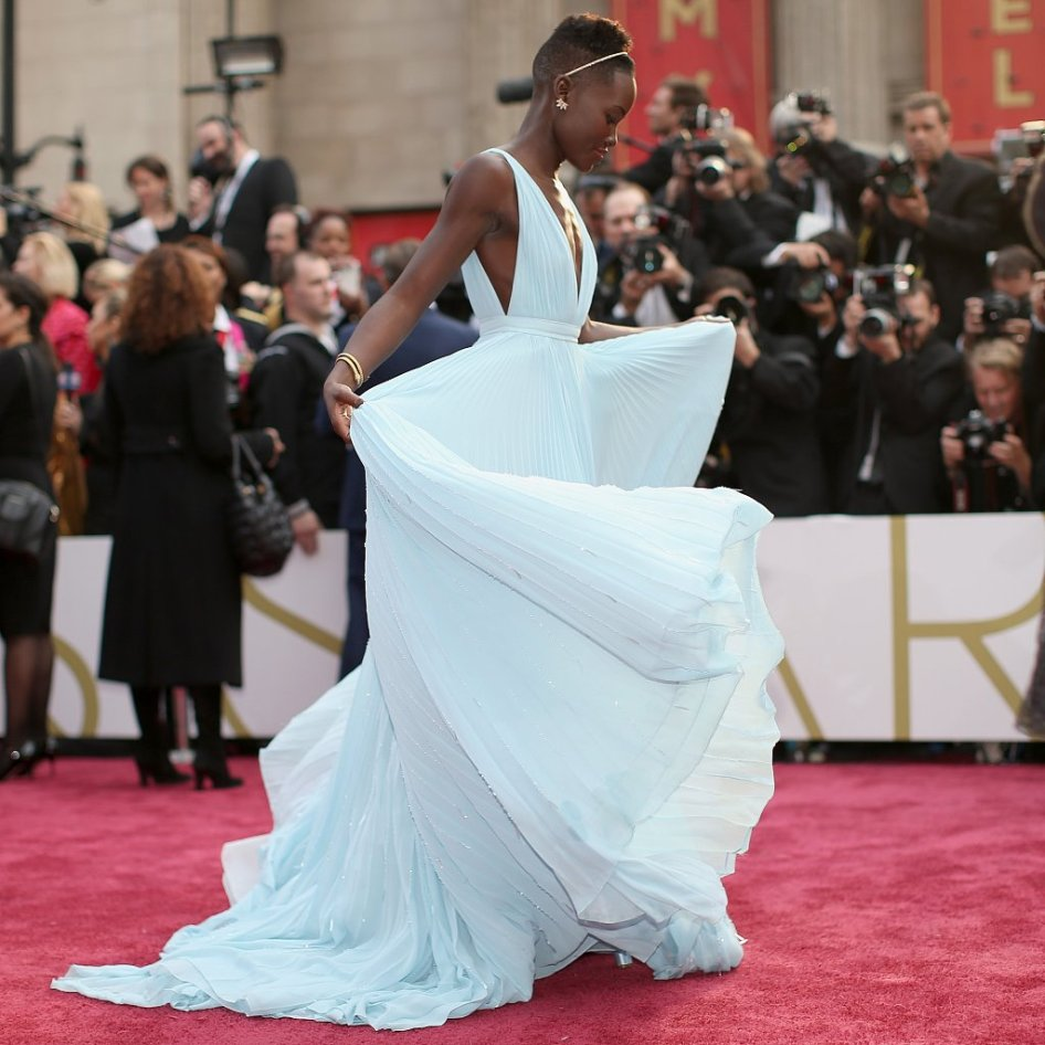 Luptia Nyong'o designed her fairy- tale dress with help from the house of Prada. She chose a light- light blue that reminded her of home in Nairobi. Designer: Prada with Lupita Nyong'o