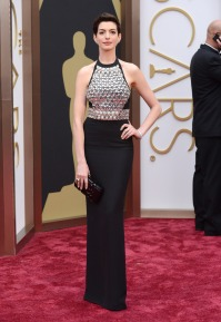 Anne Hathaway looked like she was preparing to be shot in the chest. Designer: Gucci