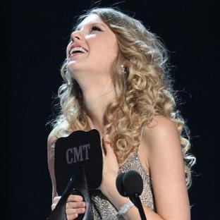 Taylor accepting an award at the CMTs