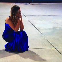 JoJo looks sad; her dress looks rad.
