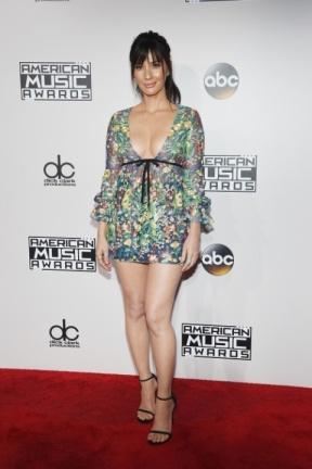 Olivia Munn looks like a midget in this shirt.