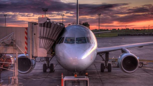 airplane boarding sunset american