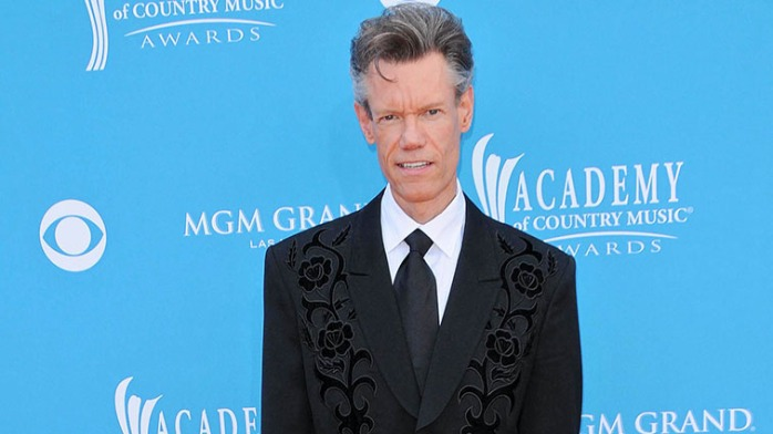 "Some of the dudes struggled with the black tie dress code. Not Randy Travis. That jacket says ""country"" AND slays."