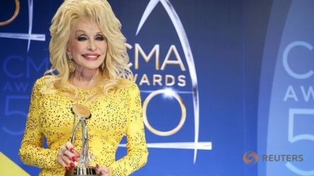 The best little songstress in Nashville poses with her Willie Nelson Lifetime Achievement Award.