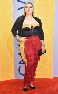 Circus ringleader? Fringed curtain? The prince from Cinderella? Whatever her inspiration, Elle King's attitude rocked this.