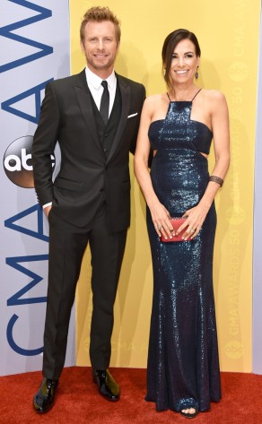 Dierks sports a perfectly fitted three- piece suit and wife Cassidy Black stole the show every time the camera hit her navy sparkles.