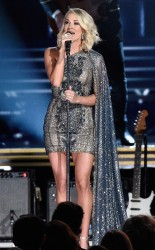 Carrie's CMA wardrobe changes are a running joke. For the show's opening, she wore this showstopping paisley cape dress.