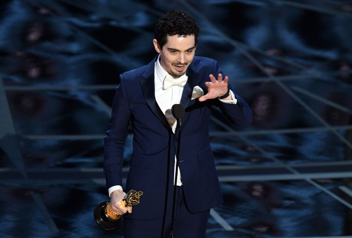 Best Director Damien Chazelle's Burberry blends into the blue