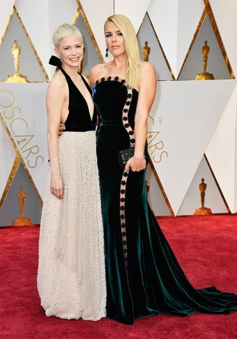 Michelle Williams sports tiny tiers with Busy Phillips. Williams wears custom Louis Vuitton, Phillips wears Elizabeth Kennedy