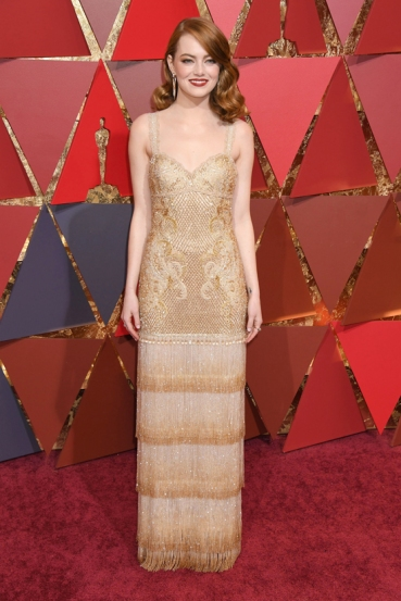 ★ Best Actress winner Emma Stone shimmered in champagne Givenchy