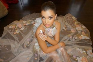 Hailee Steinfeld poses backstage with her nail polish