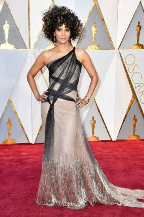 """""""Oscars so BLACK!"""" said historic Oscar winner Halle Berry- she was the first black woman to win Best Actress. The star wore Versace and a big wig."""