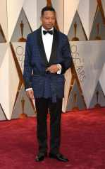 The eclectic Terrence Howard wears and navy smoking jacket