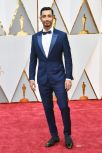 Tall Riz Ahmed, of Rogue One and Girls, wears Ermenegildo Zegna Couture.
