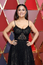 Salma Hayek shows off her inner Material Girl with black lace and a headband. Dress by Alexander McQueen.