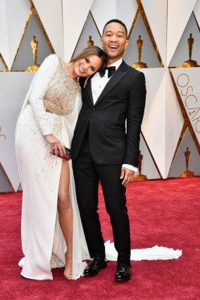 Here are Perfect Celebrity Couple Chrissy Teigen and John Legend. Chrissy wears Zuhair Murad.