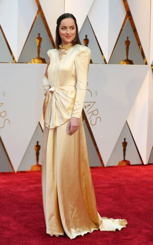 ★ Dakota Johnson should really always have bangs, but I give her mad props for this conservative satin crepe Gucci.