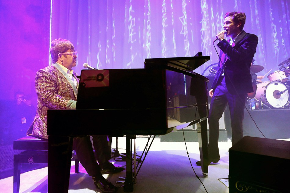 Elton John and Brandon Flowers perform togeter.jpg