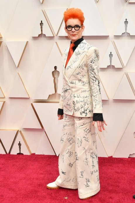 Prolific period costume designer Sandy Powell got this year's nominees to sign her suit, which she will auction for The Art Fund